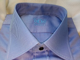 blue shirt with black buttons